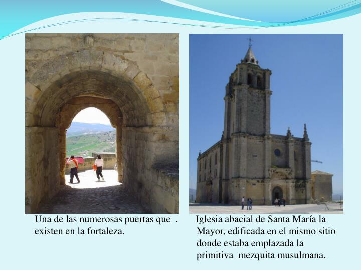 Una de las numerosas puertas que  .       Iglesia abacial de Santa María la existen en la fortaleza.       Mayor, edificada en el mismo sitio        donde estaba emplazada la        primitiva  mezquita musulmana.