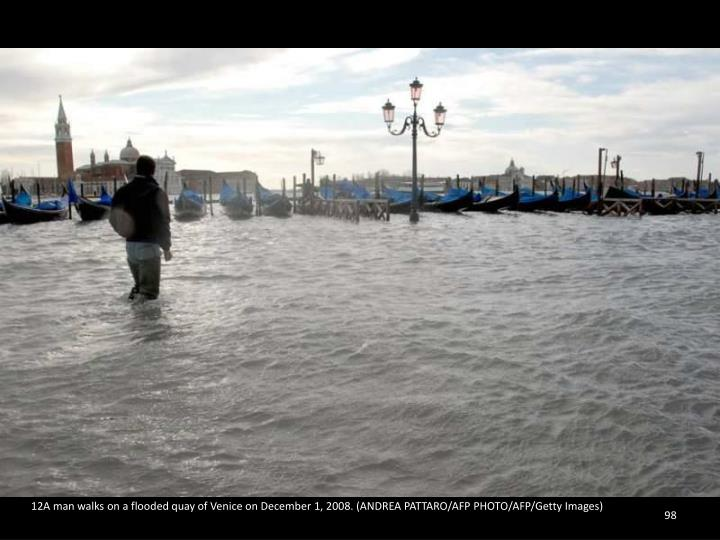 12A man walks on a flooded quay of Venice on December 1, 2008. (ANDREA PATTARO/AFP PHOTO/AFP/Getty Images)