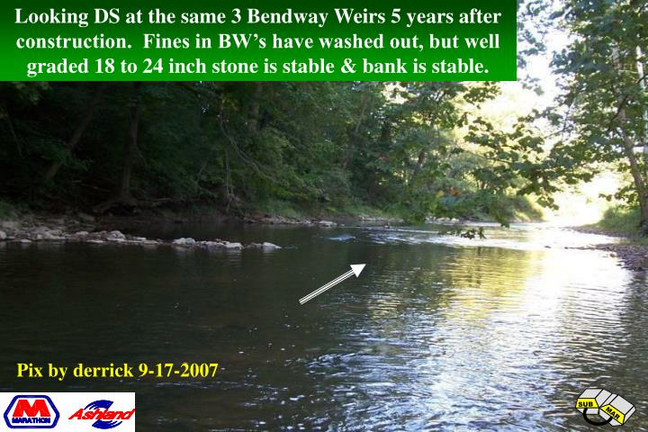 Looking DS at the same 3 Bendway Weirs 5 years after construction.  Fines in BW's have washed out, but well graded 18 to 24 inch stone is stable & bank is stable.
