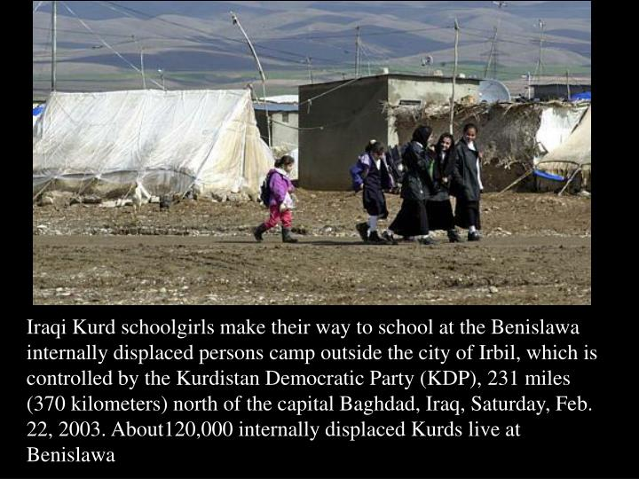 Iraqi Kurd schoolgirls make their way to school at the Benislawa internally displaced persons camp outside the city of Irbil, which is controlled by the Kurdistan Democratic Party (KDP), 231 miles (370 kilometers) north of the capital Baghdad, Iraq, Saturday, Feb. 22, 2003. About120,000 internally displaced Kurds live at Benislawa