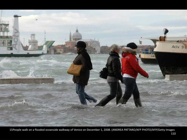 15People walk on a flooded oceanside walkway of Venice on December 1, 2008. (ANDREA PATTARO/AFP PHOTO/AFP/Getty Images