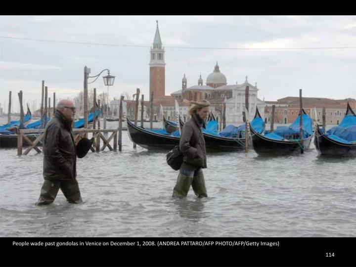 People wade past gondolas in Venice on December 1, 2008. (ANDREA PATTARO/AFP PHOTO/AFP/Getty Images)