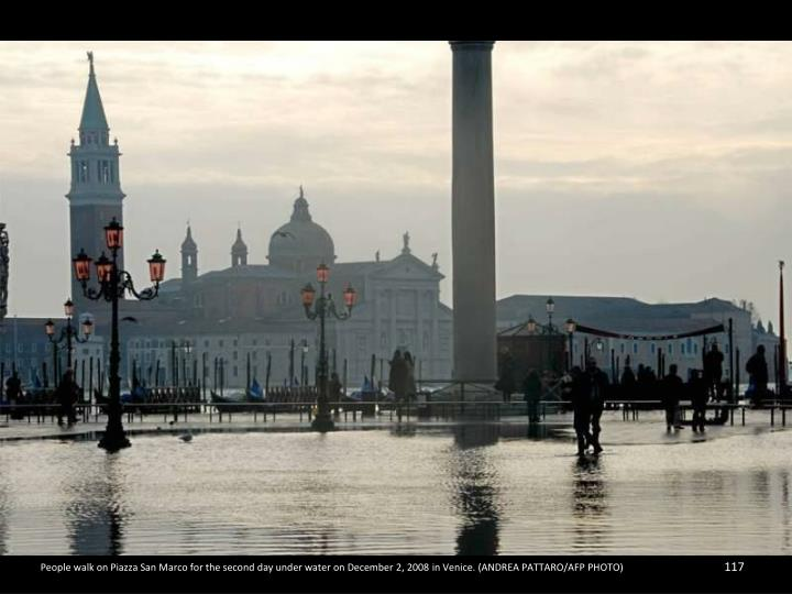 People walk on Piazza San Marco for the second day under water on December 2, 2008 in Venice. (ANDREA PATTARO/AFP PHOTO)