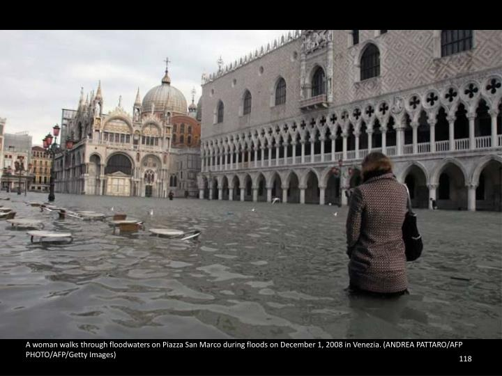 A woman walks through floodwaters on Piazza San Marco during floods on December 1, 2008 in Venezia. (ANDREA PATTARO/AFP PHOTO/AFP/Getty Images)