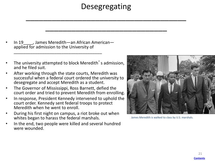 James Meredith is walked to class by U.S. marshals.