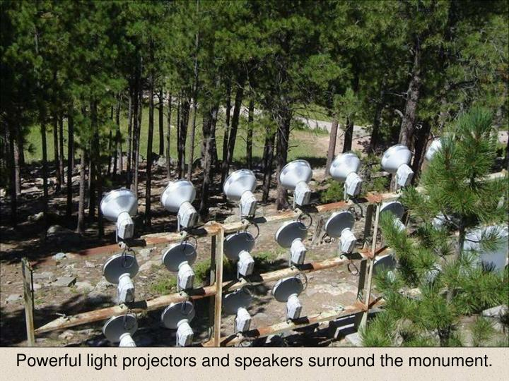 Powerful light projectors and speakers surround the monument.
