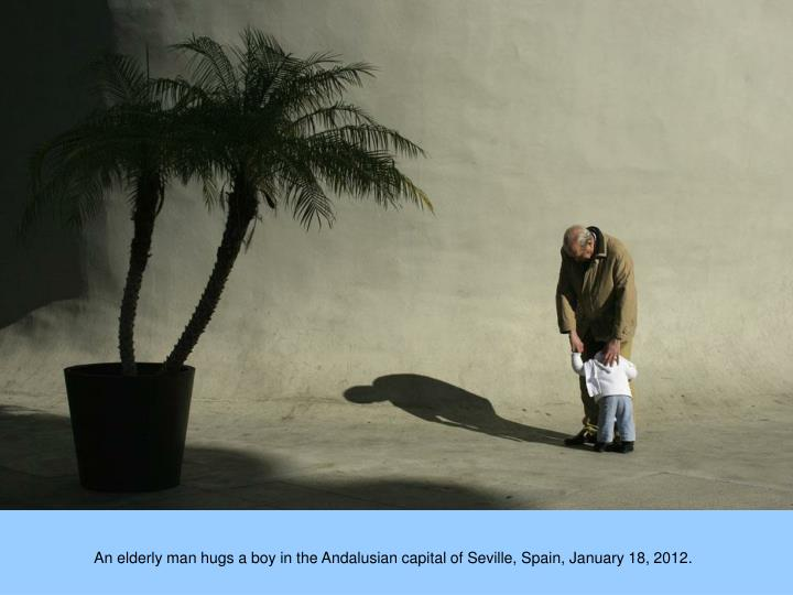 An elderly man hugs a boy in the Andalusian capital of Seville, Spain, January 18, 2012.
