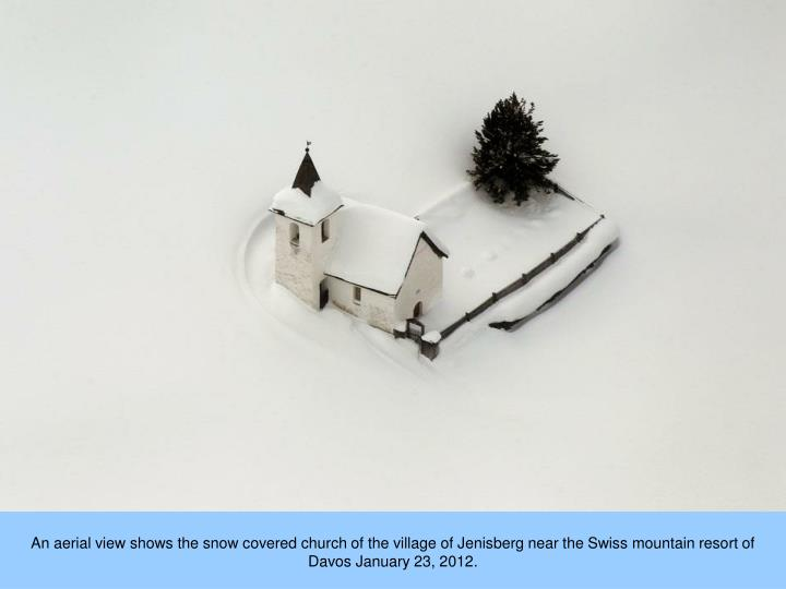 An aerial view shows the snow covered church of the village of Jenisberg near the Swiss mountain resort of Davos January 23, 2012.