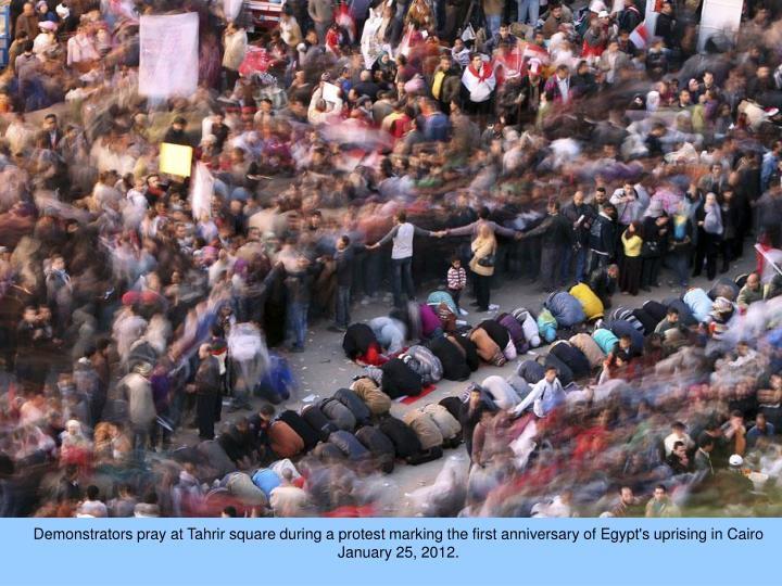 Demonstrators pray at Tahrir square during a protest marking the first anniversary of Egypt's uprising in Cairo January 25, 2012.