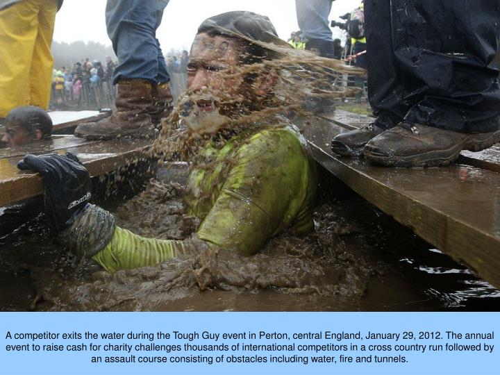A competitor exits the water during the Tough Guy event in Perton, central England, January 29, 2012. The annual event to raise cash for charity challenges thousands of international competitors in a cross country run followed by an assault course consisting of obstacles including water, fire and tunnels.