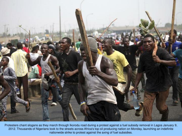 Protesters chant slogans as they march through Ikorodu road during a protest against a fuel subsidy ...