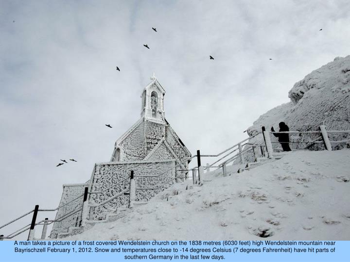 A man takes a picture of a frost covered Wendelstein church on the 1838 metres (6030 feet) high Wendelstein mountain near Bayrischzell February 1, 2012. Snow and temperatures close to -14 degrees Celsius (7 degrees Fahrenheit) have hit parts of southern Germany in the last few days.