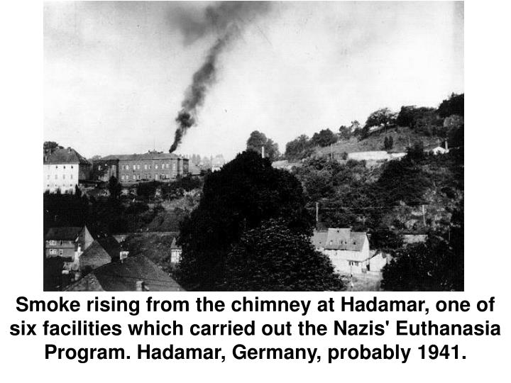 Smoke rising from the chimney at Hadamar, one of six facilities which carried out the Nazis' Euthanasia Program. Hadamar, Germany, probably 1941.