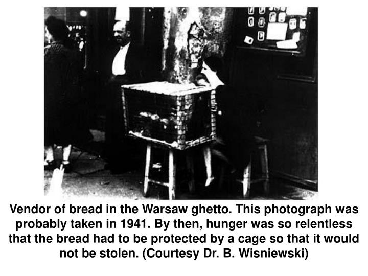 Vendor of bread in the Warsaw ghetto. This photograph was probably taken in 1941. By then, hunger was so relentless that the bread had to be protected by a cage so that it would not be stolen. (Courtesy Dr. B. Wisniewski)
