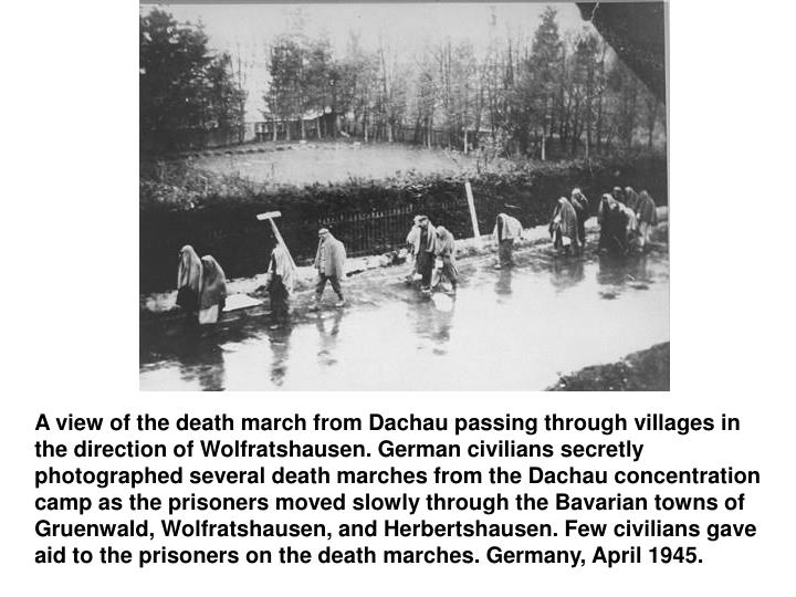 A view of the death march from Dachau passing through villages in the direction of Wolfratshausen. German civilians secretly photographed several death marches from the Dachau concentration camp as the prisoners moved slowly through the Bavarian towns of Gruenwald, Wolfratshausen, and Herbertshausen. Few civilians gave aid to the prisoners on the death marches. Germany, April 1945.