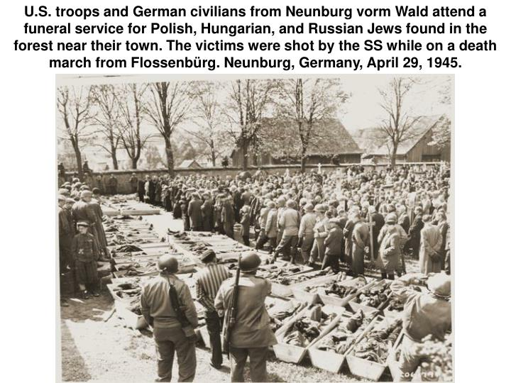U.S. troops and German civilians from Neunburg vorm Wald attend a funeral service for Polish, Hungarian, and Russian Jews found in the forest near their town. The victims were shot by the SS while on a death march from Flossenbürg. Neunburg, Germany, April 29, 1945.