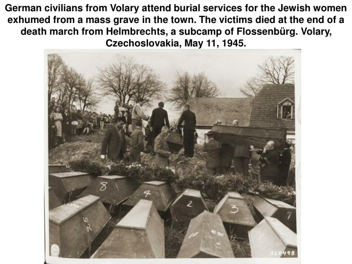 German civilians from Volary attend burial services for the Jewish women exhumed from a mass grave in the town. The victims died at the end of a death march from Helmbrechts, a subcamp of Flossenbürg. Volary, Czechoslovakia, May 11, 1945.