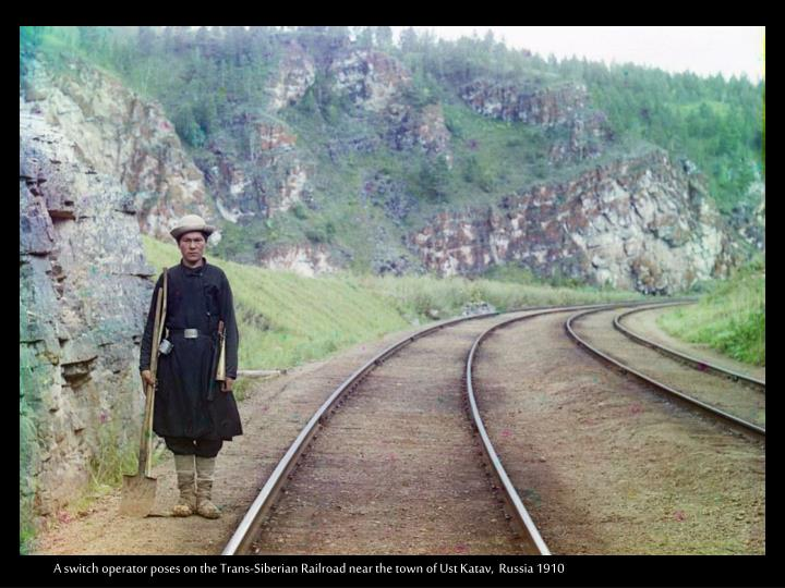 A switch operator poses on the Trans-Siberian Railroad near the town of Ust Katav,  Russia 1910