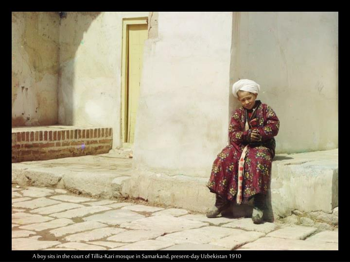 A boy sits in the court of Tillia-Kari mosque in Samarkand, present-day Uzbekistan 1910