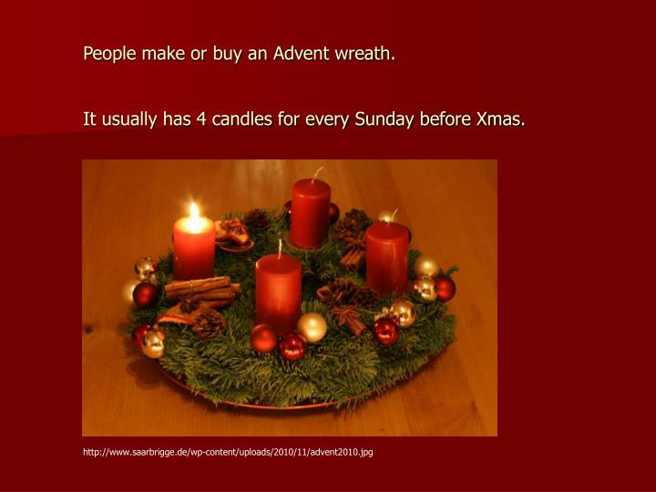 People make or buy an Advent wreath.