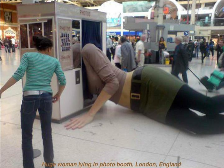 Huge woman lying in photo booth, London, England