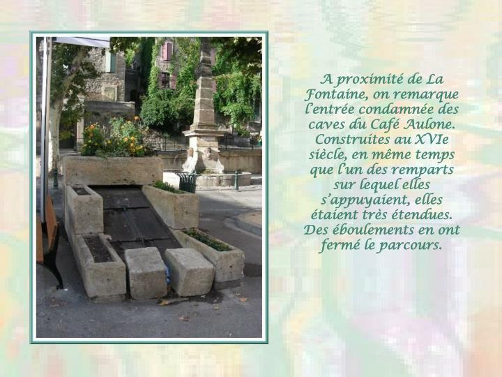 A proximit de La Fontaine, on remarque lentre condamne des caves du Caf
