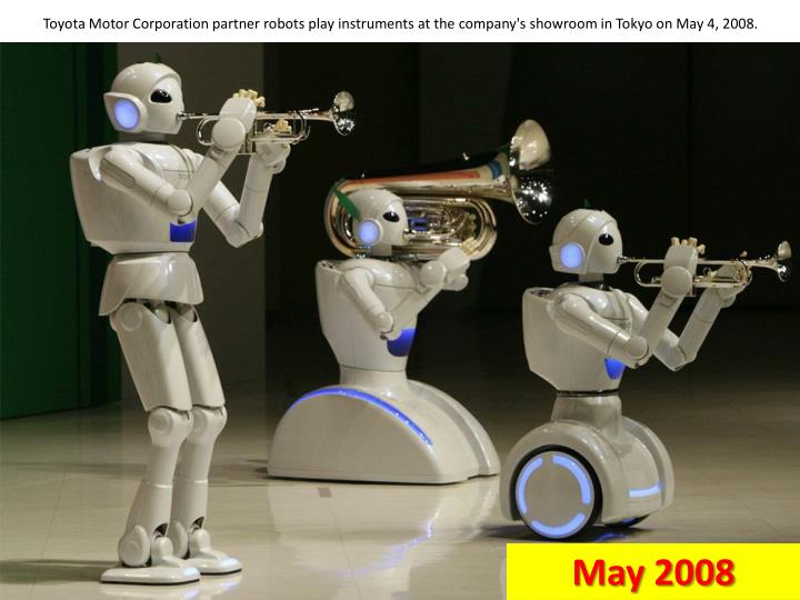 Toyota Motor Corporation partner robots play instruments at the company's showroom in Tokyo on May 4, 2008.