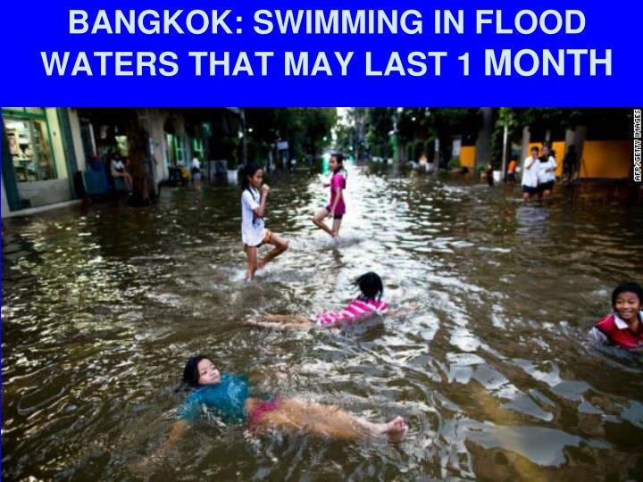 BANGKOK: SWIMMING IN FLOOD WATERS THAT MAY LAST 1