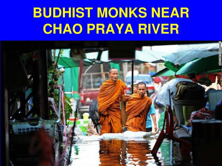 BUDHIST MONKS NEAR CHAO PRAYA RIVER