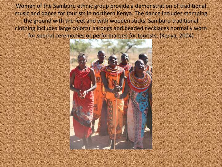 Women of the Samburu ethnic group provide a demonstration of traditional music and dance for tourists in northern Kenya. The dance includes stomping the ground with the feet and with wooden sticks. Samburu traditional clothing includes large colorful sarongs and beaded necklaces normally worn for special ceremonies or performances for tourists. (Kenya, 2004)