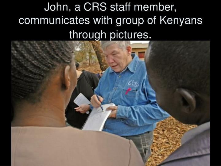 John, a CRS staff member, communicates with group of Kenyans through pictures