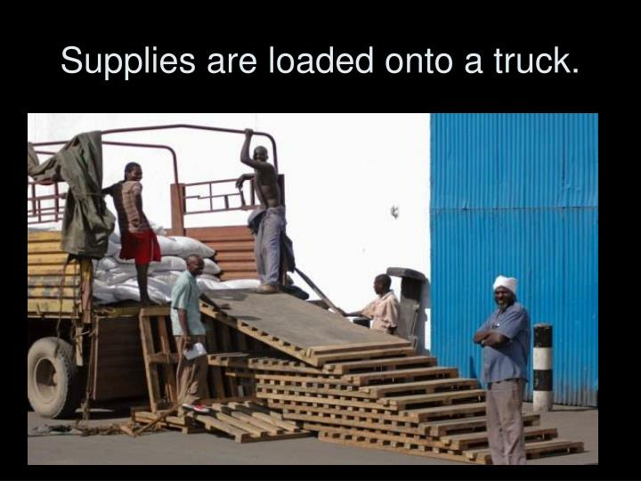 Supplies are loaded onto a truck.