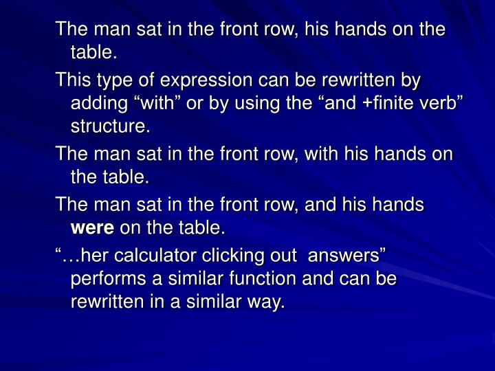 The man sat in the front row, his hands on the table.