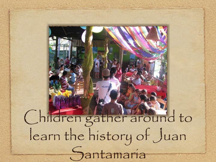 Children gather around to learn the history of Juan Santamaria