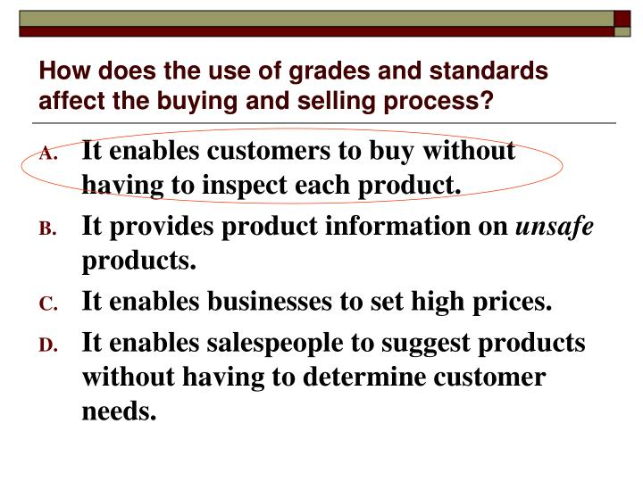 How does the use of grades and standards affect the buying and selling process?
