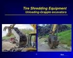 tire shredding equipment unloading grapple excavators