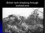 british tank breaking through barbed wire