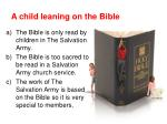 a child leaning on the bible