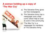 a woman holding up a copy of the war cry