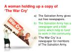 a woman holding up a copy of the war cry1