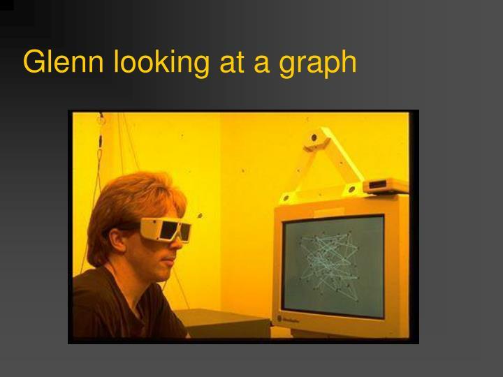 Glenn looking at a graph