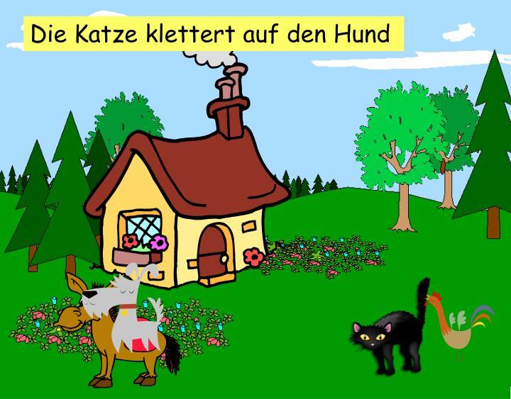 Die Katze klettert auf den Hund