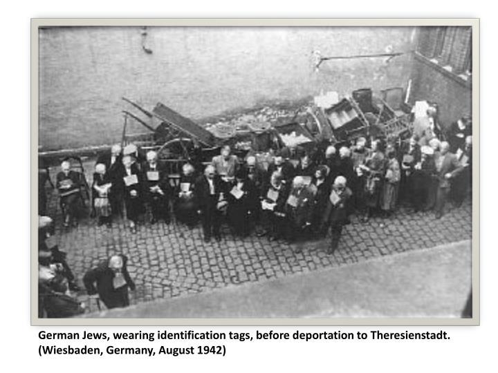 German Jews, wearing identification tags, before deportation to Theresienstadt. (Wiesbaden, Germany, August 1942)