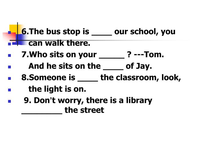 6.The bus stop is ____ our school, you