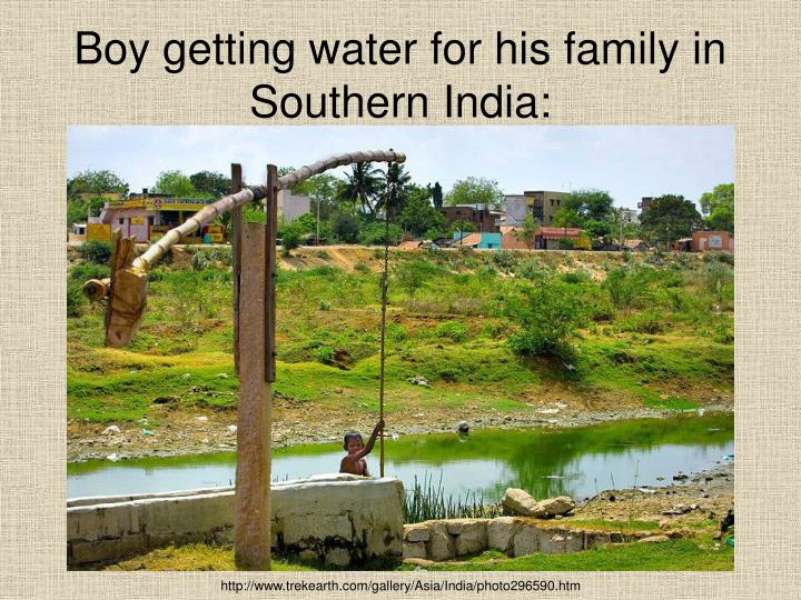 Boy getting water for his family in Southern India: