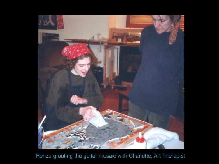 Renzo grouting the guitar mosaic with Charlotte, Art Therapist