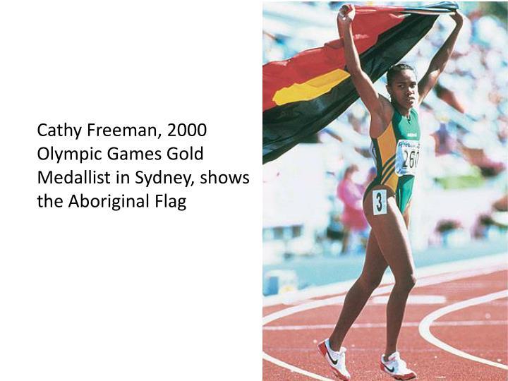 Cathy Freeman, 2000 Olympic Games Gold Medallist in Sydney, shows the Aboriginal Flag