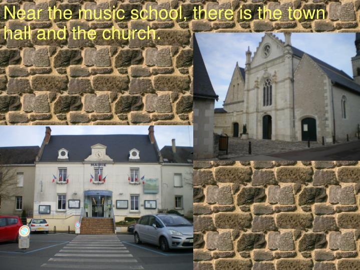 Near the music school, there is the town hall and the church.