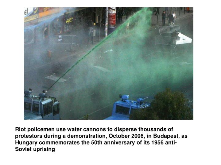 Riot policemen use water cannons to disperse thousands of protestors during a demonstration, October 2006, in Budapest, as Hungary commemorates the 50th anniversary of its 1956 anti-Soviet uprising