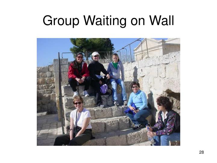 Group Waiting on Wall